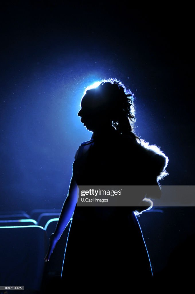 Silhouette of Woman on Blue Background : Stock Photo