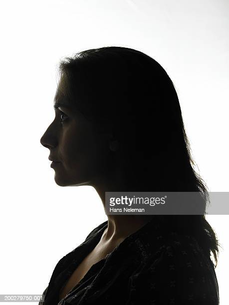 silhouette of woman, side view, close-up - back lit stock pictures, royalty-free photos & images