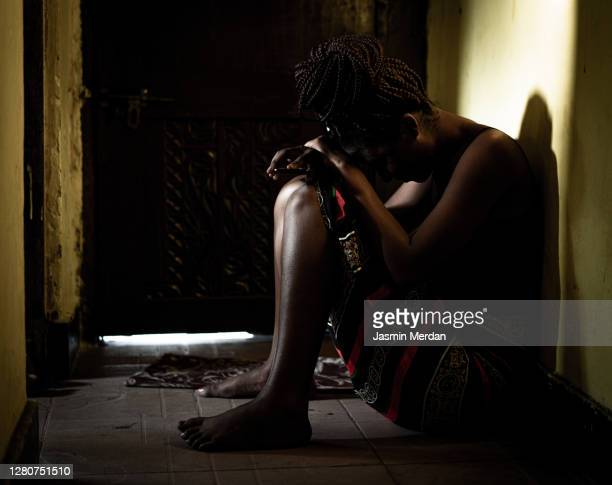 silhouette of woman sitting in a dark - aids stock pictures, royalty-free photos & images