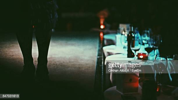 Silhouette Of Woman Standing By Table