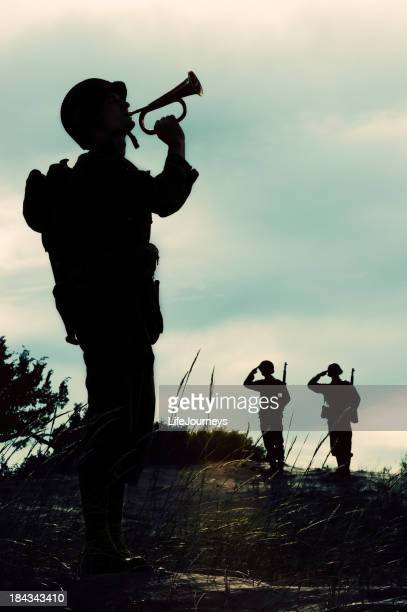 silhouette of wwii  soldier playing taps  at  days  end - bugle stock pictures, royalty-free photos & images