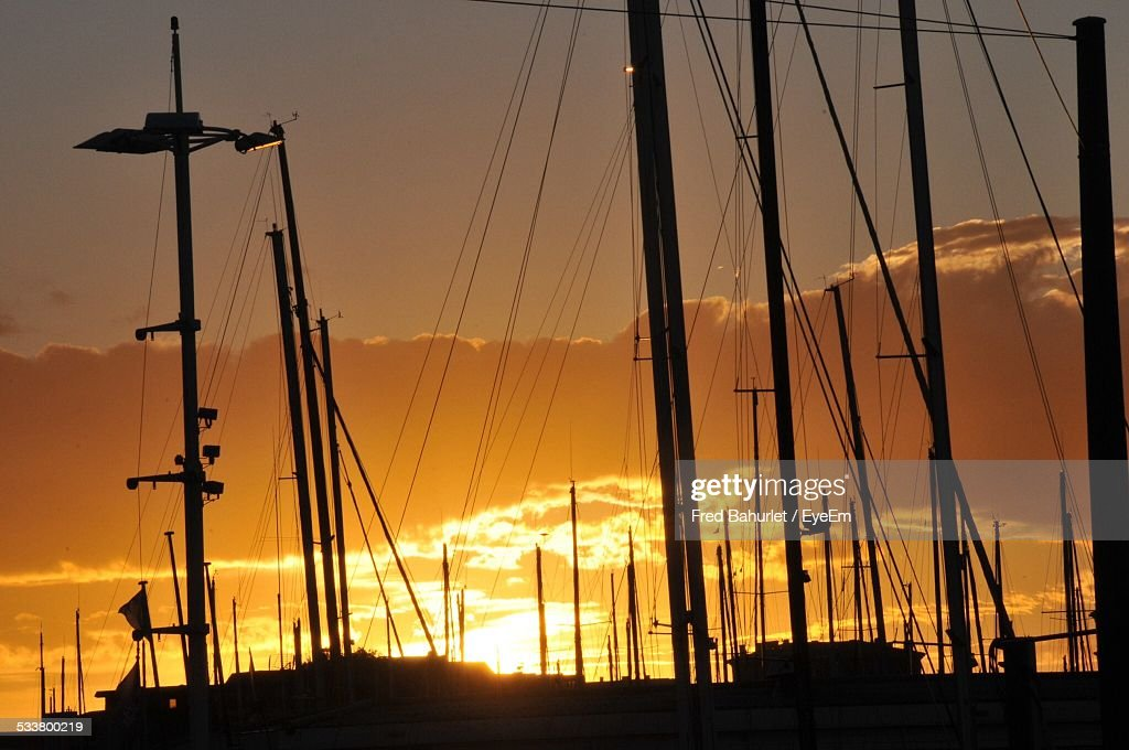 Silhouette Of Yacht Masts Against Sunset : Foto stock