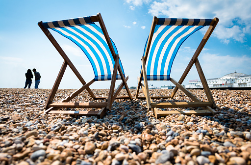 Silhouette of Young Couple and Two Empty Deck Chairs and the Palace Pier, Brighton - gettyimageskorea