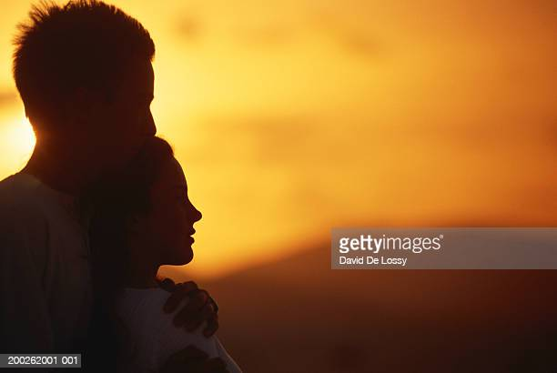 Silhouette of young couple, side view