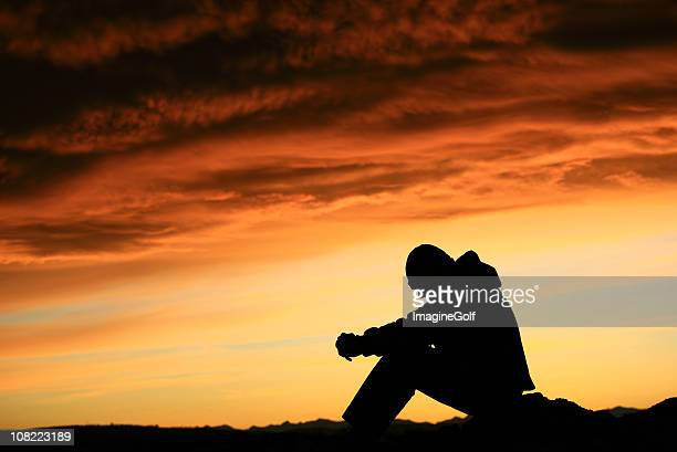 Silhouette of Young Man Contemplating Life