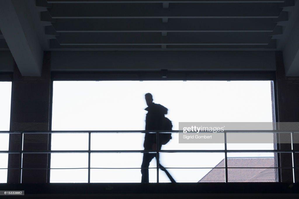 Silhouette of young student walking in a hallway, Freiburg im Breisgau, Baden-Württemberg, Germany : Stock-Foto