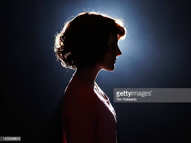 silhouette of young woman. - back lit stock pictures, royalty-free photos & images