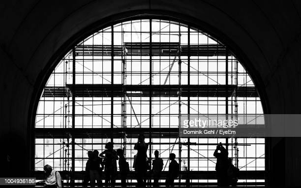 Silhouette People Against Window At Railroad Station Platform