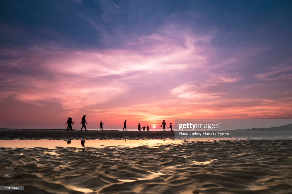 Silhouette People At Beach Against Sky During Sunset : Photo