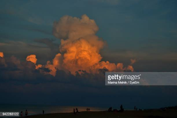 silhouette people at beach against sky during sunset - kitty hawk beach stock pictures, royalty-free photos & images