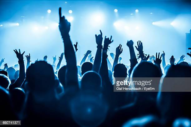 silhouette people at music concert - live event stock pictures, royalty-free photos & images