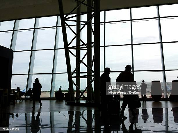 silhouette people at the airport - zaventem airport stock pictures, royalty-free photos & images