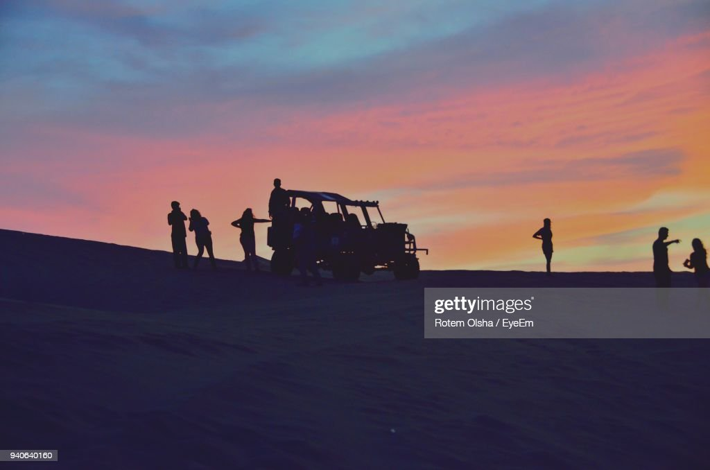 Silhouette People By Buggy At Desert During Sunset : Stock Photo