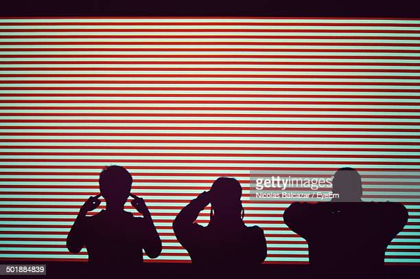 silhouette people covering eyes ears and mouth - see no evil hear no evil speak no evil stock pictures, royalty-free photos & images