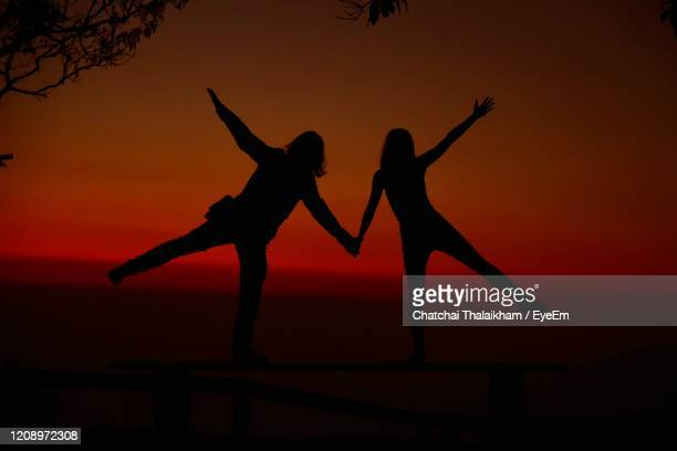 silhouette people dancing against sky during sunset - chatchai thalaikham stock pictures, royalty-free photos & images
