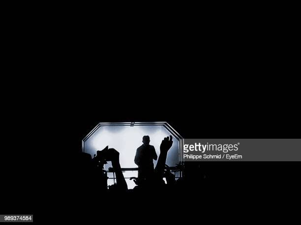 silhouette people during music concert at night - stage performance space stock pictures, royalty-free photos & images