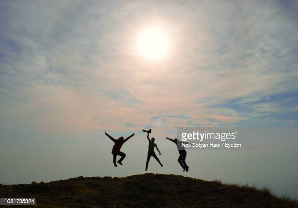 Silhouette People Enjoying On Hill Against Sky During Sunset