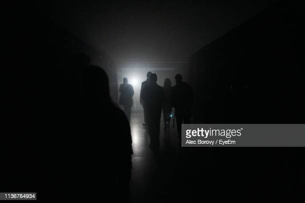 silhouette people in darkroom - darkroom stock pictures, royalty-free photos & images