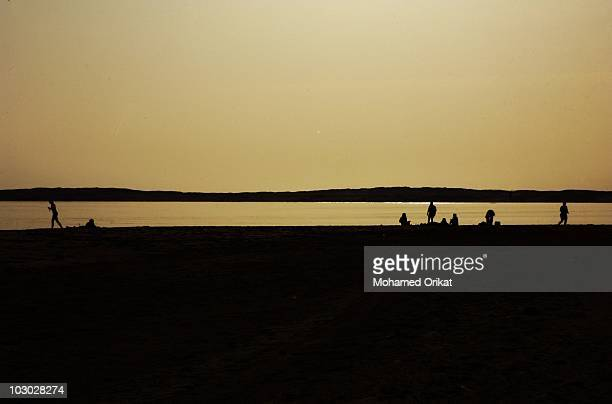 Silhouette people on beach