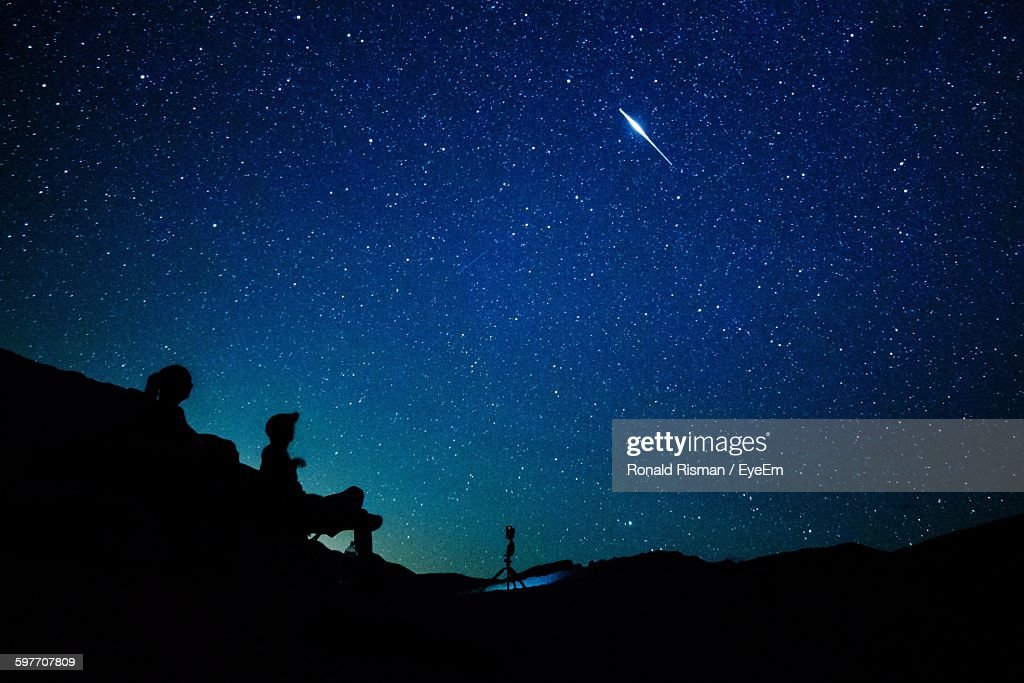 Silhouette People On Mountain Against Stars In Sky : Stock Photo