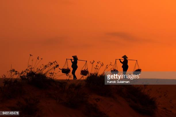 Silhouette people The red sand Mui Ne red sand hills in Binh Thuan, Vietnam