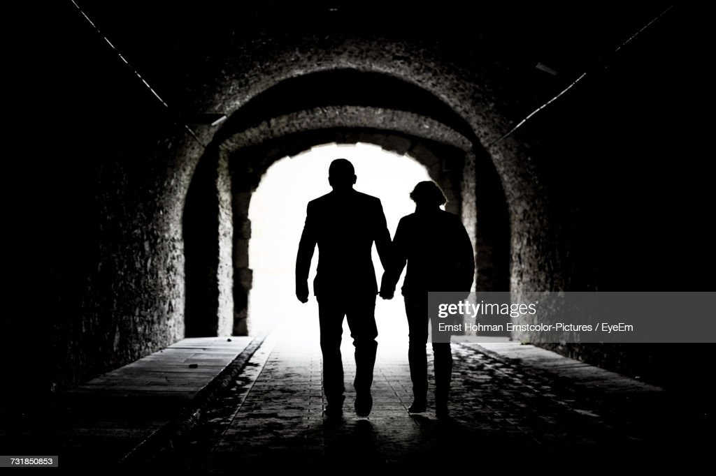 Silhouette People Walking In Tunnel Stock Photo Getty Images