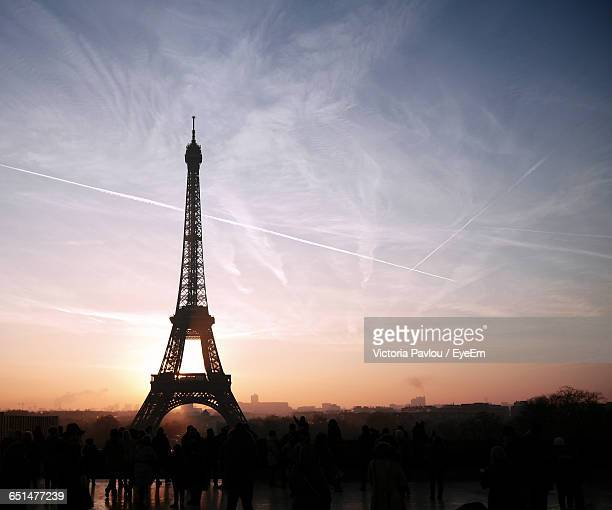 Silhouette People With Eiffel Tower Against Sky During Sunset
