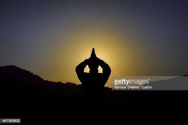 Silhouette Person In Prayer Position Against Clear Sky