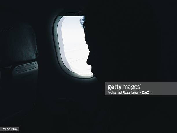 Silhouette Person Traveling In Airplane