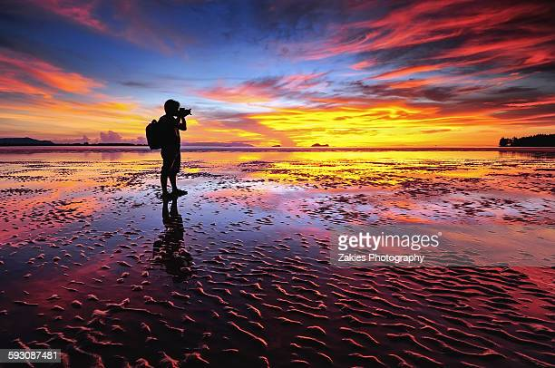 silhouette photographer at puteri beach sarawak - sarawak state stock pictures, royalty-free photos & images