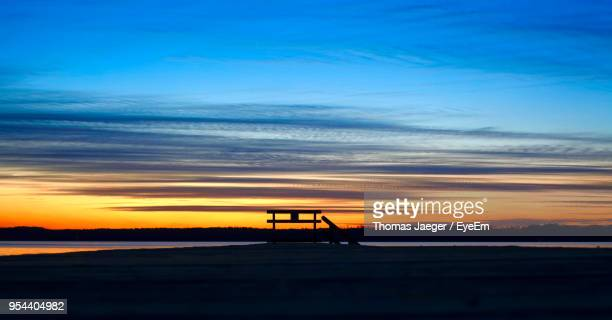 Silhouette Pier Against Sky During Sunset
