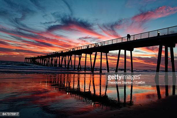 silhouette pier at beach against sky during sunset - hermosa beach stock pictures, royalty-free photos & images
