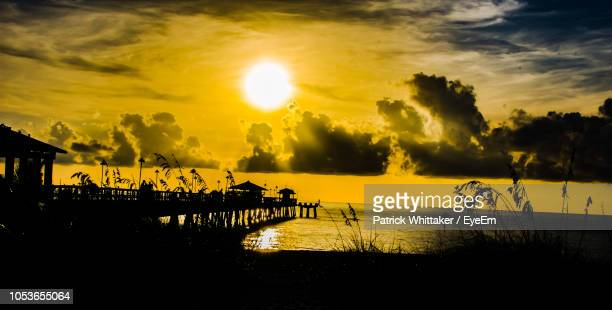 silhouette pier over lake against sky during sunset - sunrise fort lauderdale bildbanksfoton och bilder