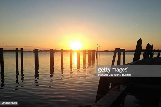 Silhouette Pier Over Lake Against Sky During Sunset