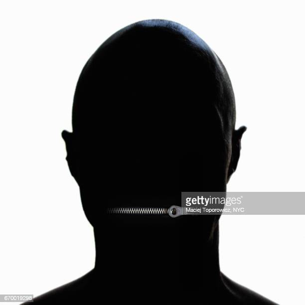 Silhouette portrait of a man with zipped mouth.