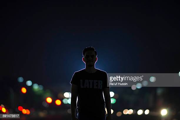 Silhouette portrait of man at night city