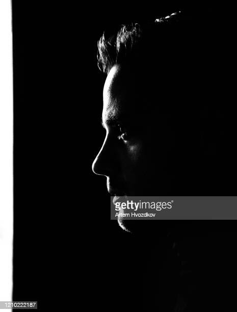 silhouette portrait of young man - profile stock pictures, royalty-free photos & images