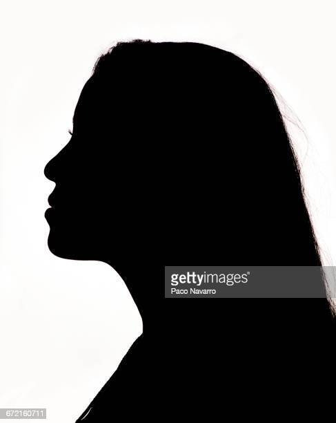 silhouette profile of hispanic woman - shadow forms stock photos and pictures
