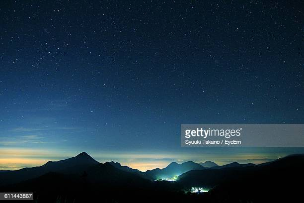 Silhouette Rocky Mountains Against Starry Sky