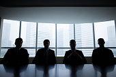 Silhouette row of businessmen sitting in meeting room