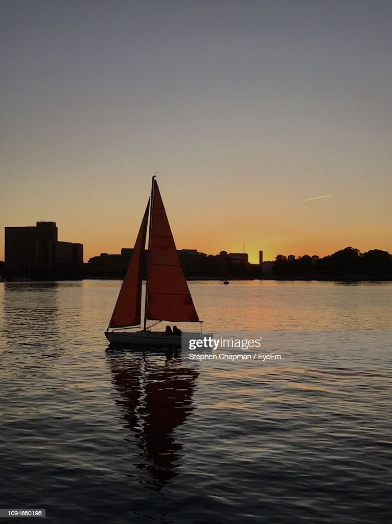 Silhouette Sailboat On Sea Against Clear Sky During Sunset : ストックフォト