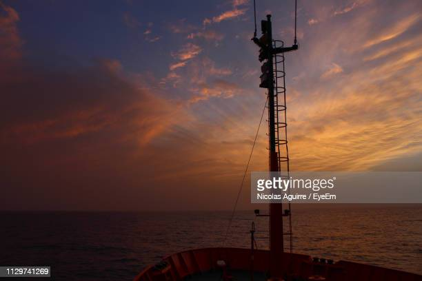 Silhouette Sailboat On Sea Against Sky During Sunset