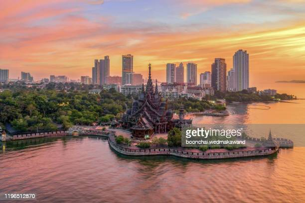 silhouette sanctuary of truth temple construction on sunset in pattaya, thailand - chonburi province stock pictures, royalty-free photos & images
