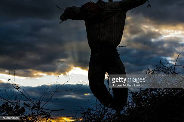 Silhouette scarecrow against scenic sky at dusk