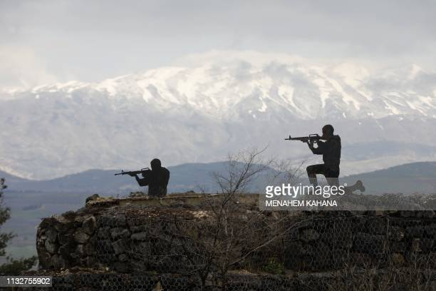 Silhouette sculptures of Israeli soldiers are pictured at an army post on Mount Bental in the Israeliannexed Golan Heights on March 25 2019 US...