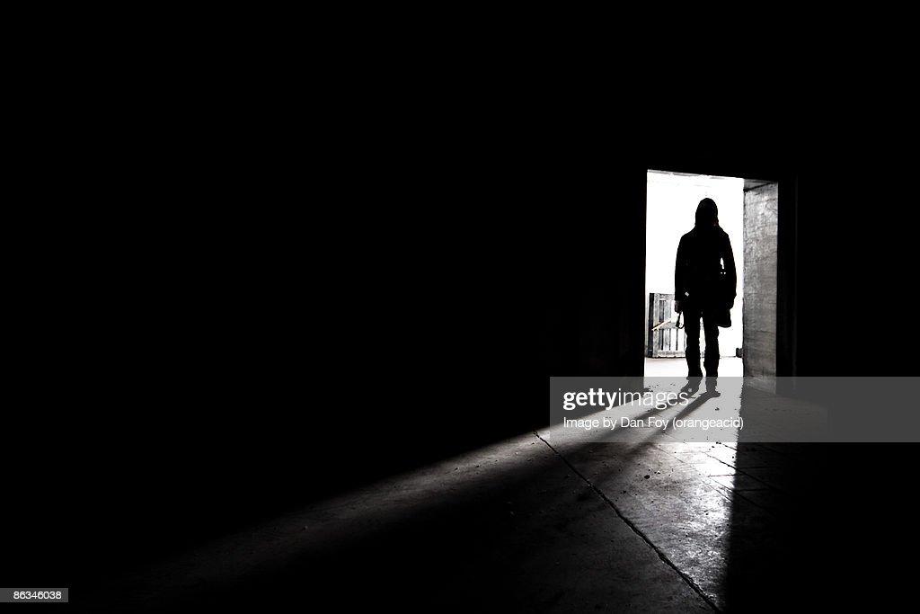 Silhouette shadow of man in doorway : Stock Photo