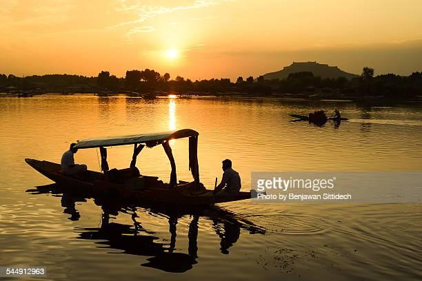 Silhouette shikara boat in Dal lake