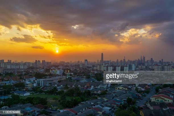 Silhouette shot of downtown Kuala Lumpur skyline at twilight in Malaysia