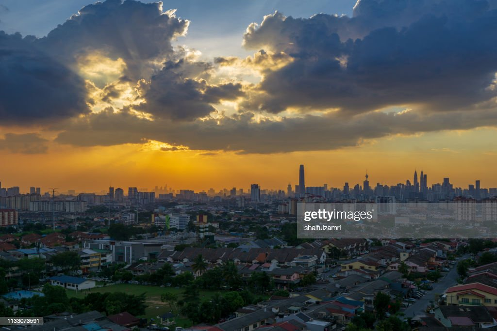 Silhouette shot of downtown Kuala Lumpur skyline at twilight in Malaysia : Stock Photo