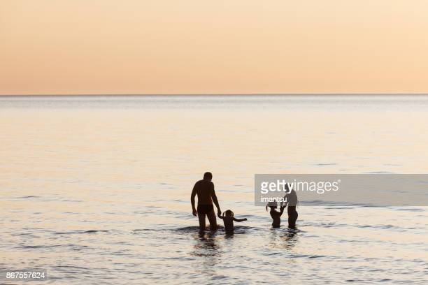 Silhouette shots of family on the beach